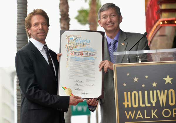 Producer Jerry Bruckheimer and Hollywood Chamber of Commerce President and CEO Leron Gubler attend Legendary Producer Jerry Bruckheimer Hollywood Walk of Fame Star Ceremony on the Hollywood Walk of Fame on June 24, 2013 in Hollywood, California.   <span class=meta>(Alberto E. Rodriguez &#47; Wireimage &#47; The Walt Disney Company)</span>