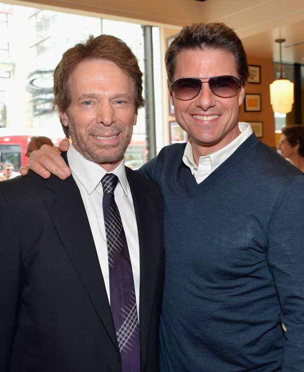 Producer Jerry Bruckheimer and actor Tom Cruise attend Legendary Producer Jerry Bruckheimer Hollywood Walk of Fame Star Ceremony on the Hollywood Walk of Fame on June 24, 2013 in Hollywood, California.