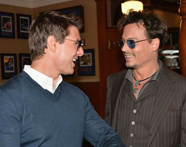 Actors Tom Cruise and Johnny Depp attends Legendary Producer Jerry Bruckheimer Hollywood Walk of Fame Star Ceremony on the Hollywood Walk of Fame on June 24, 2013 in Hollywood, California.