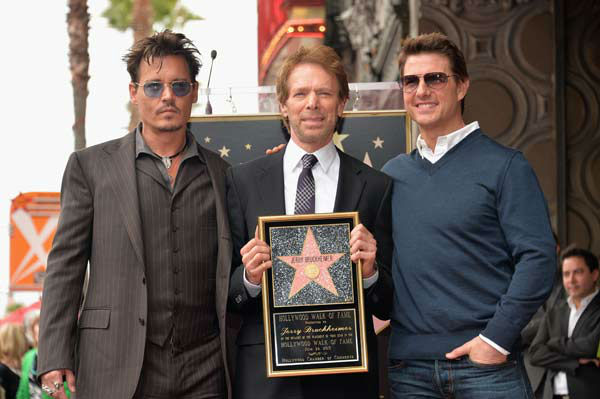 Actor Johnny Depp, producer Jerry Bruckheimer and actor Tom Cruise attend Legendary Producer Jerry Bruckheimer Hollywood Walk of Fame Star Ceremony on the Hollywood Walk of Fame on June 24, 2013 in Hollywood, California.