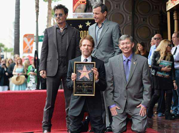 Actor Johnny Depp, producer Jerry Bruckheimer, The Walt Disney Company Chairman and CEO Bob Iger and Hollywood Chamber of Commerce President and CEO Leron Gubler attend Legendary Producer Jerry Bruckheimer Hollywood Walk of Fame Star Ceremony on the Hollywood Walk of Fame on June 24, 2013 in Hollywood, California.  <span class=meta>(Photo&#47;Alberto E. Rodriguez)</span>