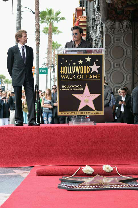 "<div class=""meta ""><span class=""caption-text "">Producer Jerry Bruckheimer and Johnny Depp speak at Legendary Producer Jerry Bruckheimer Hollywood Walk of Fame Star Ceremony on the Hollywood Walk of Fame on June 24, 2013 in Hollywood, California.  (Alberto E. Rodriguez / Wireimage / The Walt Disney Company)</span></div>"