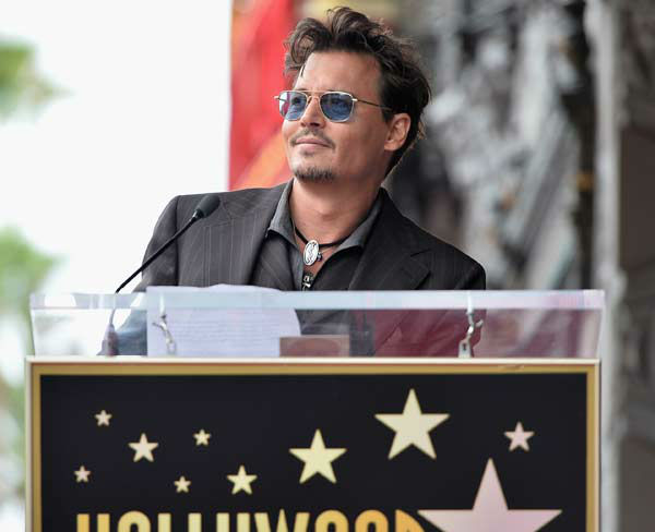 Producer Jerry Bruckheimer and Johnny Depp speak at Legendary Producer Jerry Bruckheimer Hollywood Walk of Fame Star Ceremony on the Hollywood Walk of Fame on June 24, 2013 in Hollywood, California.  <span class=meta>(Alberto E. Rodriguez &#47; Wireimage &#47; The Walt Disney Company)</span>