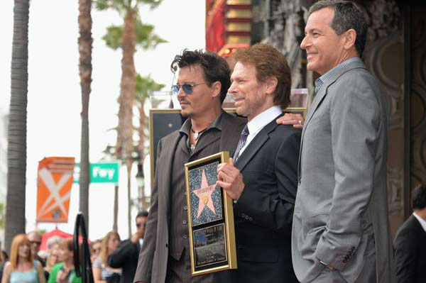 Actor Johnny Depp, producer Jerry Bruckheimer and The Walt Disney Company Chairman and CEO Bob Iger attend Legendary Producer Jerry Bruckheimer Hollywood Walk of Fame Star Ceremony on the Hollywood Walk of Fame on June 24, 2013 in Hollywood, California.  <span class=meta>(Alberto E. Rodriguez &#47; Wireimage &#47; The Walt Disney Company)</span>