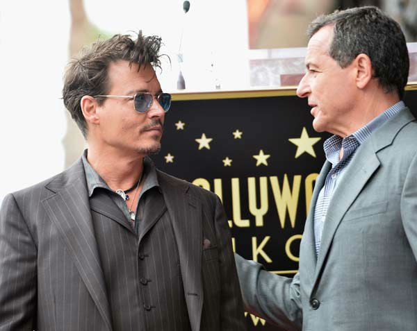 Actor Johnny Depp and The Walt Disney Company Chairman and CEO Bob Iger attend Legendary Producer Jerry Bruckheimer Hollywood Walk of Fame Star Ceremony on the Hollywood Walk of Fame on June 24, 2013 in Hollywood, California.  <span class=meta>(Alberto E. Rodriguez &#47; Wireimage &#47; The Walt Disney Company)</span>