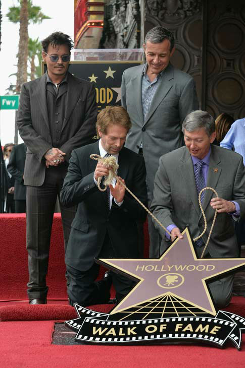 "<div class=""meta ""><span class=""caption-text "">Actor Johnny Depp, producer Jerry Bruckheimer, The Walt Disney Company Chairman and CEO Bob Iger and Hollywood Chamber of Commerce President and CEO Leron Gubler attend Legendary Producer Jerry Bruckheimer Hollywood Walk of Fame Star Ceremony on the Hollywood Walk of Fame on June 24, 2013 in Hollywood, California.  (Alberto E. Rodriguez / Wireimage / The Walt Disney Company)</span></div>"