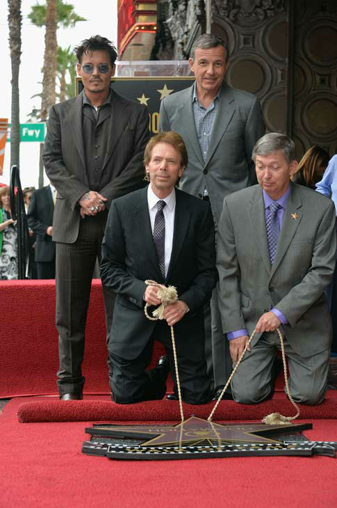 Actor Johnny Depp, producer Jerry Bruckheimer, The Walt Disney Company Chairman and CEO Bob Iger and Hollywood Chamber of Commerce President and CEO Leron Gubler on June 24, 2013.