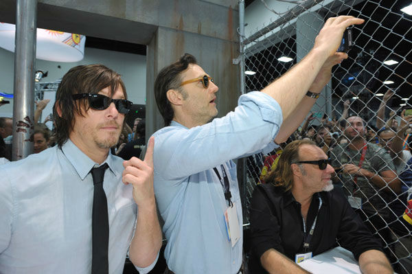 From left, Norman Reedus, David Morrissey and executive producer Gregory Nicotero attend AMC&#39;s &#39;The Walking Dead&#39; booth signing, on Friday, July 19, 2013 in San Diego, Calif. <span class=meta>(John Shearer&#47;Invision for AMC&#47;AP Images)</span>