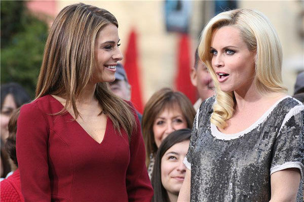 Pictured: Jenny McCarthy and 'Extra' host Maria Menounos at The Grove in Los Angeles, California on Dec. 15, 2011.