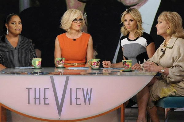 Pictured: Jenny McCarthy appearing alongside 'View' co-hosts Sherri Shepherd, Elisabeth Hasselbeck and Barbara Walters on June 5, 2013.