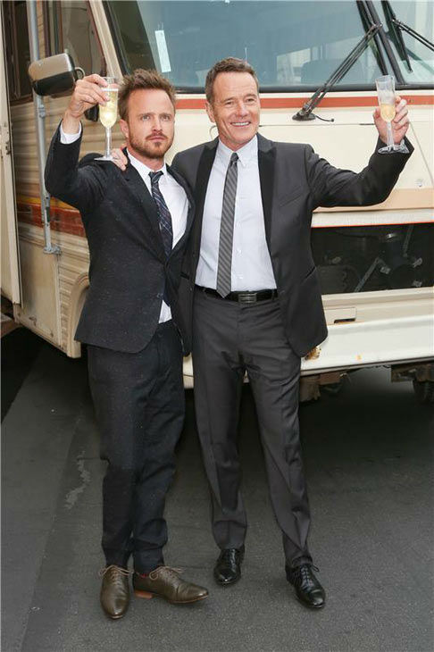 Aaron Paul and Bryan Cranston raise a toast in front of Walter and Jeese&#39;s RV at the AMC party celebrating the fifth and final season of the hit show &#39;Breaking Bad.&#39; <span class=meta>(Chris Hatcher&#47;startraksphoto.com)</span>