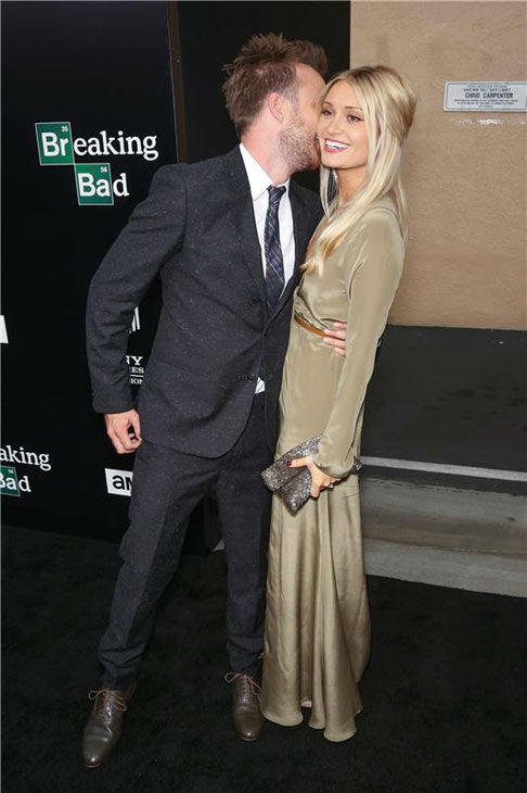 Aaron Paul and wife Lauren Parsekian share an embrace on the black carpet at the AMC party celebrating the fifth and final season of the hit show &#39;Breaking Bad.&#39; <span class=meta>(Chris Hatcher&#47;startraksphoto.com)</span>