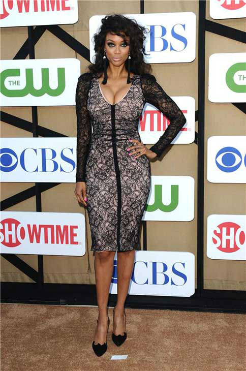 "<div class=""meta image-caption""><div class=""origin-logo origin-image ""><span></span></div><span class=""caption-text"">Tyra Banks, star of the CW show 'America's Next Top Model,' gave a signature supermodel pose at the CBS, CW and Showtime TCA event in Beverly Hills, California on July 29, 2013. (Sara De Boer/startraksphoto.com)</span></div>"