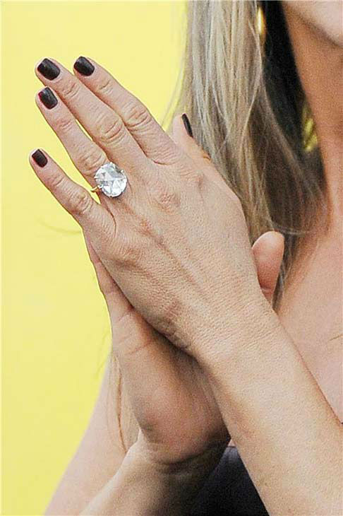 Jennifer Aniston dons a ring at the premiere of 'We're the Millers' in New York City on Aug. 1, 2013.