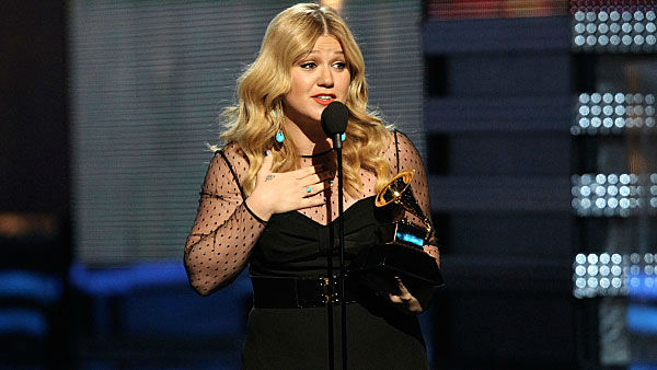Kelly Clarkson accepts a Grammy Award for Best Pop Vocal Album for Stronger at the 55th Annual Grammy Awards.