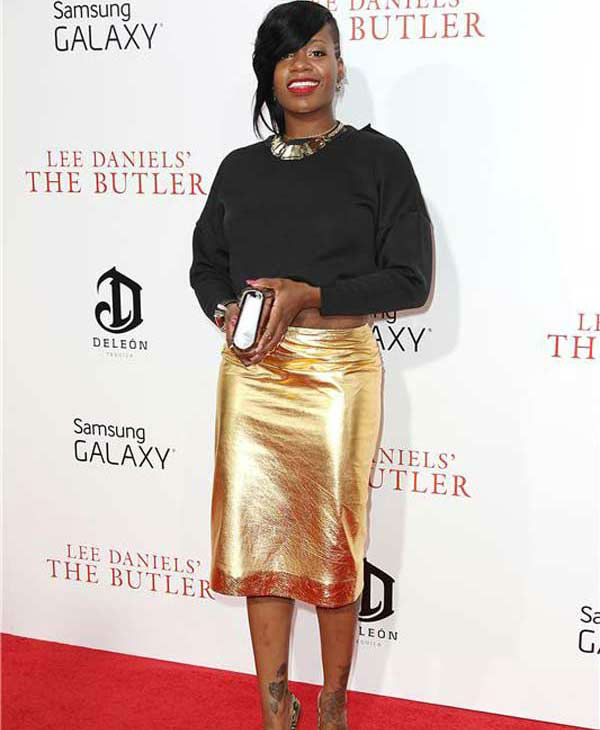 Fantasia Barrino sports a black long-sleeve top and metallic gold skirt at the New York premiere of 'Lee Daniels' The Butler' on Aug. 5, 2013.