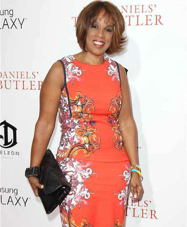 Gayle King, a long-time friend of Oprah Winfrey, wears an orange patterned dress at the New York premiere of 'Lee Daniels' The Butler' on Aug. 5, 2013.