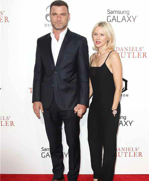 Liev Schreiber and Naomi Watts, sporting a black jumpsuit, hold hands on the red carpet at the New York premiere of 'Lee Daniels' The Butler' on Aug. 5, 2013.