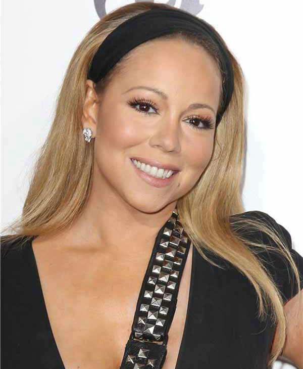 Mariah Carey strikes a smile despite still sporting a sling due to a shoulder injury at the New York premiere of 'Lee Daniels' The Butler' on Aug. 5, 2013.