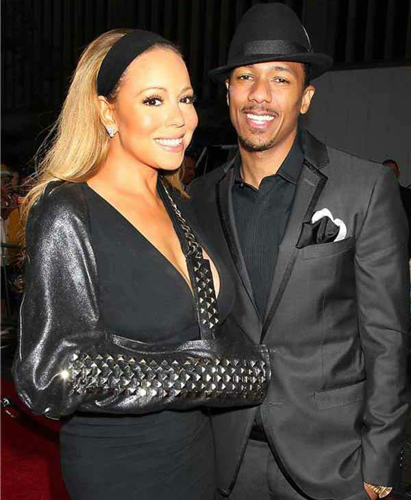 Mariah Carey and husband Nick Cannon pose together for photographers at the New York premiere of 'Lee Daniels' The Butler' on Aug. 5, 2013.