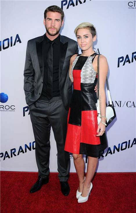 "<div class=""meta ""><span class=""caption-text "">Miley Cyrus and Liam Hemsworth appear at the Los Angeles premiere of 'Paranoia' on Aug. 8, 2013. (Sara De Boer/startraksphoto.com)</span></div>"