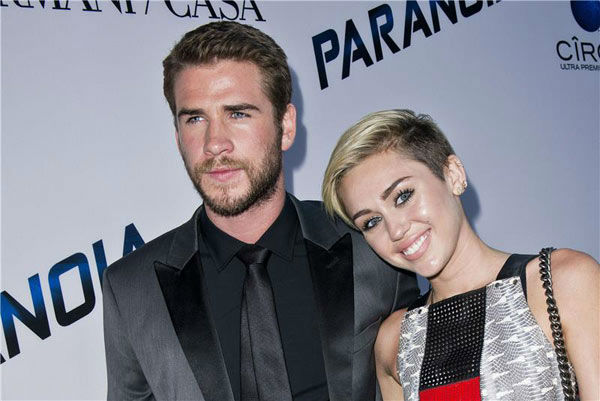Miley Cyrus and Liam Hemsworth appear at the Los Angeles premiere of 'Paranoia' on Aug. 8, 2013.