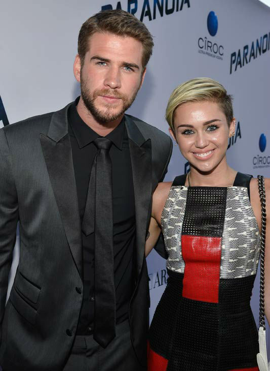 Actor Liam Hemsworth and singer Miley Cyrus attend the premiere of &#39;Paranoia&#39; at DGA Theater on Aug. 8, 2013 in Los Angeles, California. <span class=meta>(Frazer Harrison&#47;Getty Images for Relativity Media)</span>