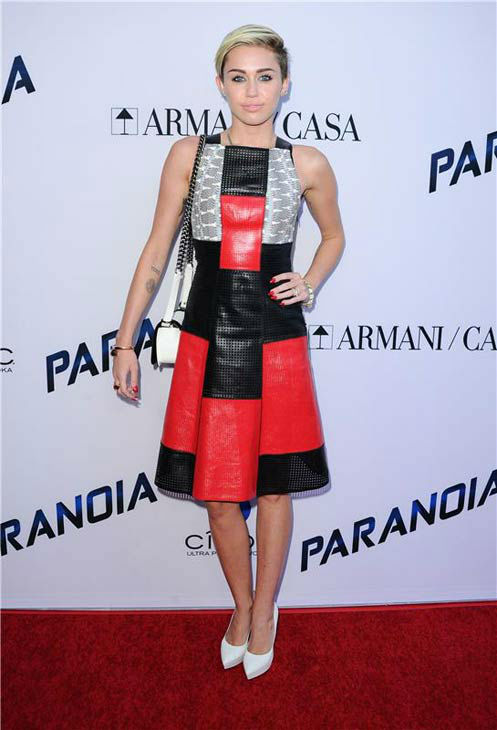 Miley Cyrus appears at the Los Angeles premiere of 'Paranoia' on Aug. 8, 2013.