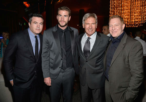 Relativity Media's Tucker Tooley, actors Liam Hemsworth, Harrison Ford and Relativity Media's Ryan Kavanaugh attend the after party of the premiere of 'Paranoia' at DGA Theater on Aug. 8, 2013 in Los Angeles, California.