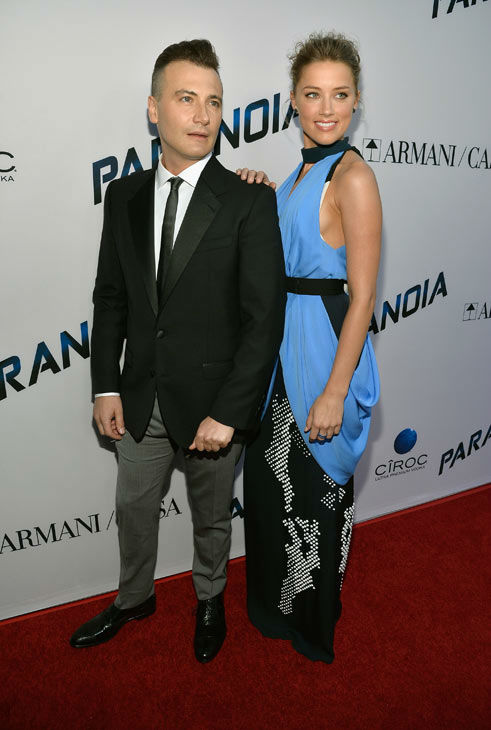 Director Robert Luketic and actress Amber Heard attend the premiere of 'Paranoia' at DGA Theater on Aug. 8, 2013 in Los Angeles, California.