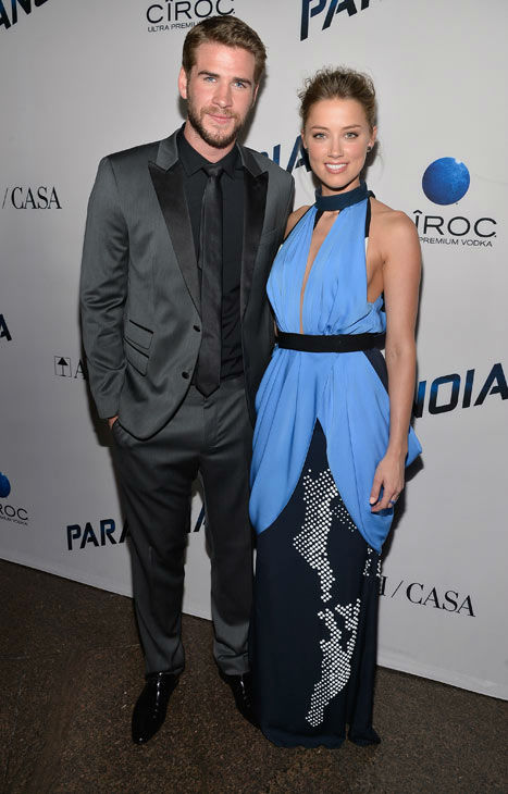 Liam Hemsworth and Amber Heard attend the premiere of 'Paranoia' at DGA Theater on Aug. 8, 2013 in Los Angeles, California.