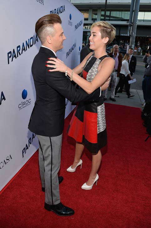 Miley Cyrus and 'Paranoia' director Robert Luketic attend the premiere of 'Paranoia' at DGA Theater on Aug. 8, 2013 in Los Angeles, California.