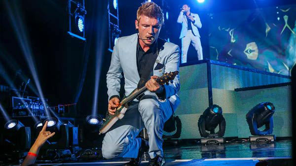 Nick Carter plays guitar on stage with the Backstreet Boys on their 'In a World Like This Tour' in Raleigh, North Carolina.