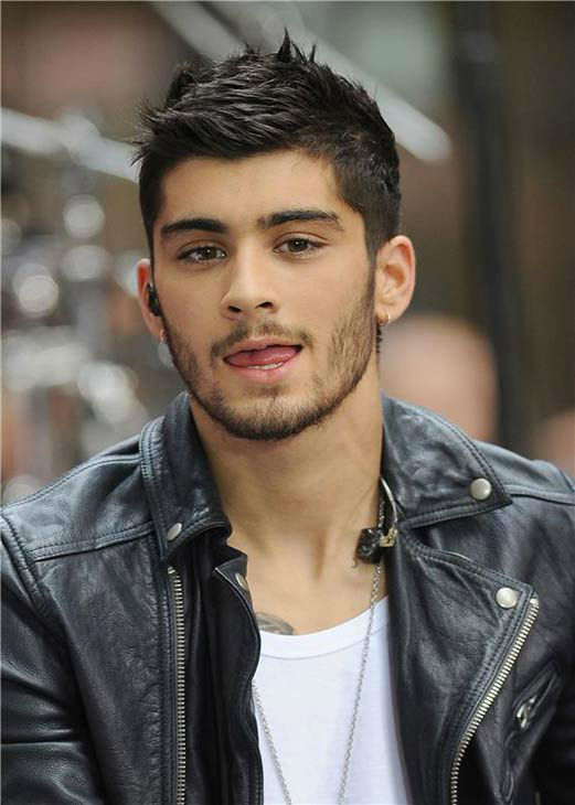 "<div class=""meta ""><span class=""caption-text "">Zayn Malik appears during One Direction's performance on the 'Today' show on Aug. 23, 2013.  (Humberto Carreno/startraksphoto.com)</span></div>"