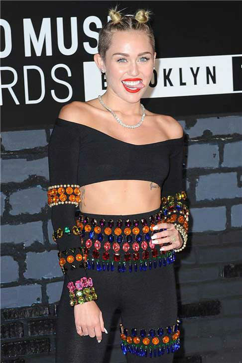 "<div class=""meta image-caption""><div class=""origin-logo origin-image ""><span></span></div><span class=""caption-text"">Miley Cyrus appears at the 2013 MTV Video Music Awards in Brooklyn, New York on Aug. 25, 2013.  (Humberto Carreno / startraksphoto.com)</span></div>"