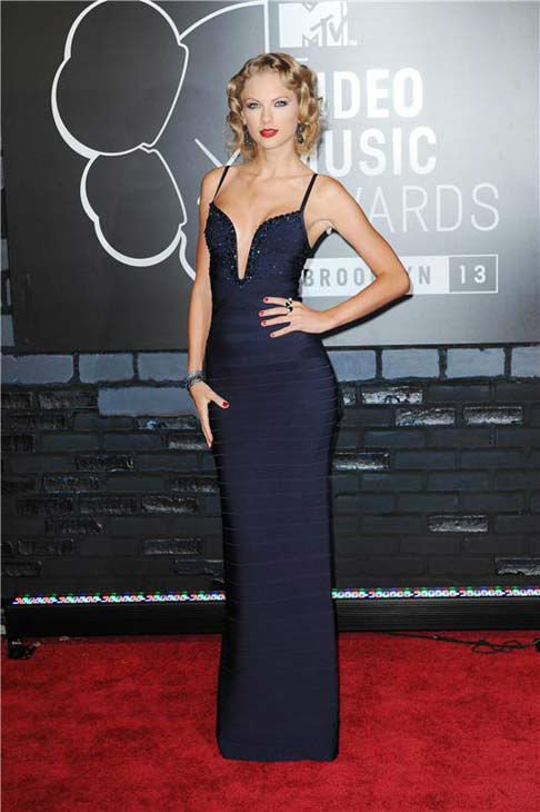Taylor Swift rocked a navy blue Herve Leger by Max Azria gown on the red carpet of the 2013 MTV Video Music Award at the Barclays Center in Brooklyn, New York on Aug. 25, 2013.