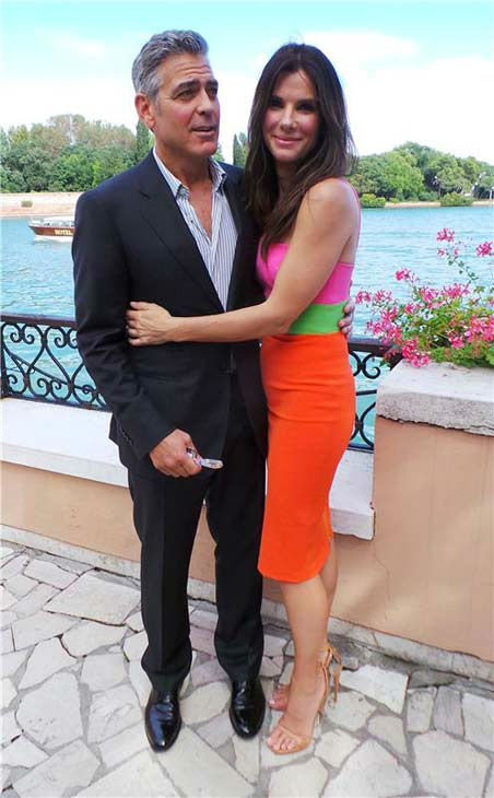 Sandra Bullock hugs George Clooney at a 'Gravity' photo call at the 2013 Venice Film Festival in Venice, Italy on Aug. 28, 2013.