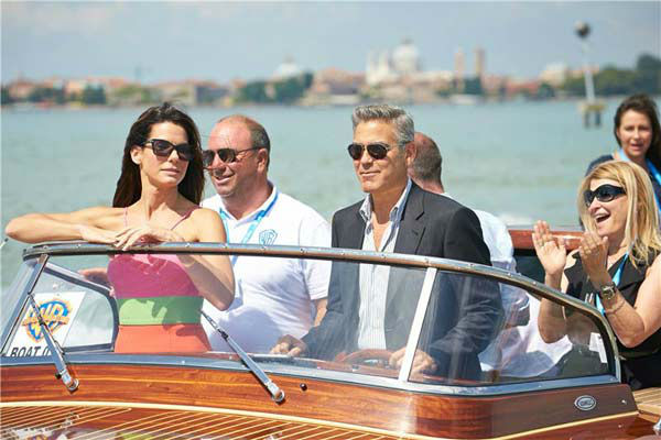Sandra Bullock and George Clooney take a water taxi to the 70th Venice Film Festival on Aug. 28, 2013. <span class=meta>(ACTION PRESS&#47;startraksphoto.com)</span>