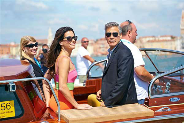 Sandra Bullock and George Clooney take a water taxi to the 70th Venice Film Festival on Aug. 28, 2013.