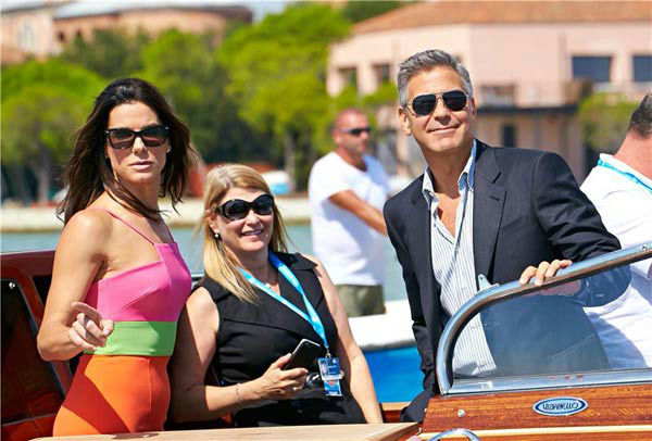 Sandra Bullock and George Clooney take a water taxi to the 70th Venice Film