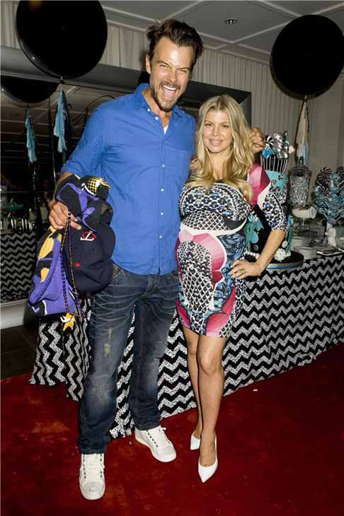 "<div class=""meta ""><span class=""caption-text "">Black Eyed Peas singer Fergie and husband, actor Josh Duhamel, welcomed their first child, a baby boy named Axl Jack, on Aug. 29, 2013. The singer announced her pregnancy on Twitter back in February 2013, tweeting to her over 2 million followers, ""Josh & Me & BABY makes three!!! #mylovelybabybump.""    (Pictured: Fergie and Josh Duhamel at their baby shower on July 28, 2013 at the SLS Hotel in Los Angeles, California.) (Justin Campbell / startraksphoto.com)</span></div>"
