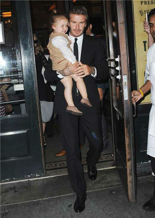 David Beckham with daughter Harper leave Balthazar Restaurant during Mercedes-Benz Fashion Week on Sept. 8, 2013.