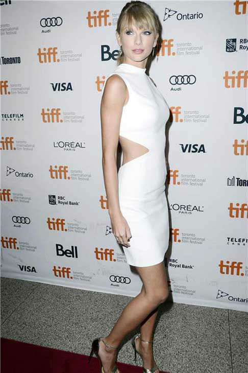 Taylor Swift wore a sexy white and cut-out Calvin Klein dress at the Toronto International Film Festival premiere of &#34;One Chance&#34; on Sept. 9, 2013. <span class=meta>(Christian Lapid &#47; startraksphoto.com)</span>