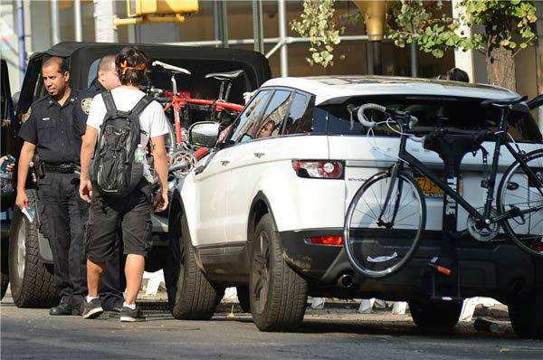 The bicyclist is seen talking to New York City police officers after the incident on Sept. 12, 2013.