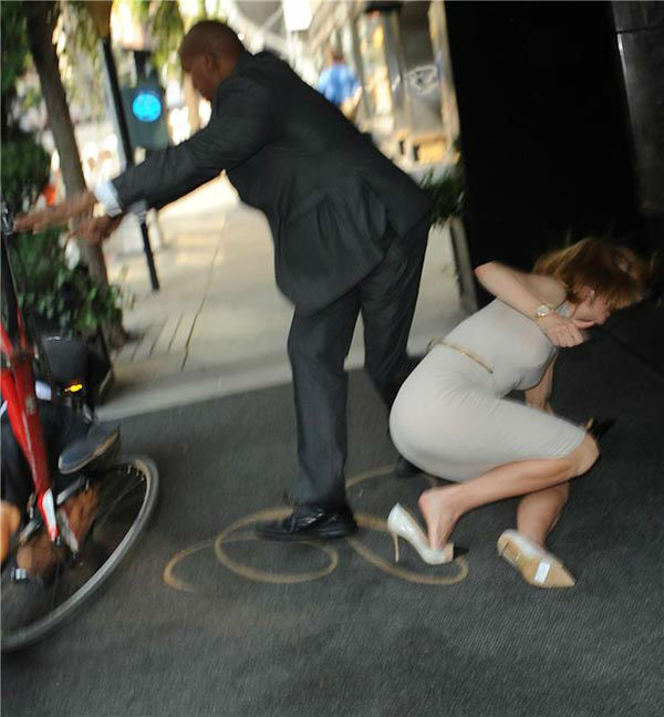Nicole Kidman is seen on the ground after she and a bicyclist were both knocked down on a New York sidewalk on Sept. 12, 2013.