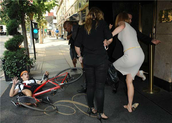 Nicole Kidman is seen getting up off the ground after she and a bicyclist were both knocked down on a New York sidewalk on Sept. 12, 2013.