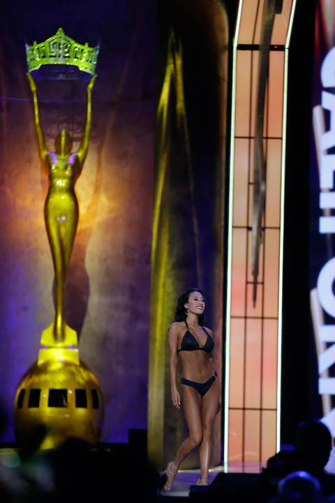 Miss California Crystal Lee shows off her bikini body in Catalina Swimwear's special Miss America collection during the swimsuit competition of the 2014 Miss America pageant.