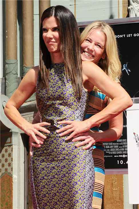 Sandra Bullock appears with comedienne Chelsea Handler at the TCL Chinese Theatre in Los Angeles, California on Sept. 25, 2013 for a commemorative hand and footprint ceremony.