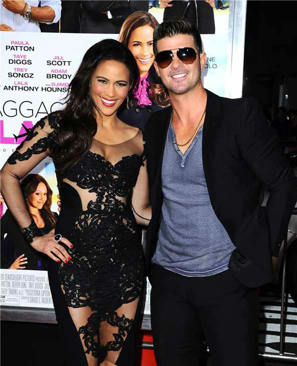 Paula Patton and Robin Thicke appear at the Los Angeles, California premiere of 'Baggage Claim' on Sept. 25, 2013.