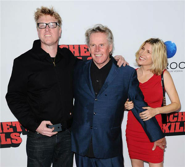 Gary Busey and his family appears at the 'Machete Kills' premiere in Los Angeles, California on Oct. 2, 2013.